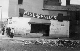Loyalist banner and graffiti on a building in a side street off the Shankill Road, Belfast, 1970