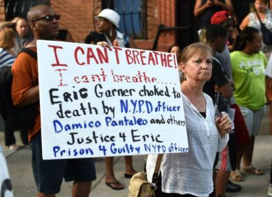 People gather outside the funeral service for Eric Garner at the Bethel Baptist Church in Brooklyn (Timothy A. Clary/AFP/Getty)
